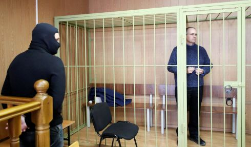 Former US marine Paul Whelan, who is being held on suspicion of spying, in the courtroom cage after a ruling regarding extension of his detention, in Moscow. Photograph: Shamil Zhumatov/Reuters