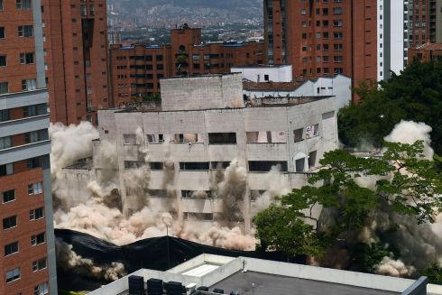 The Monaco building, which was once home to Colombian drug lord Pablo Escobar, is demolished in Medellin, Colombia.  The site will become a park in memory of the victims of the drug war. Photograph: Joaquin Sarmiento/AFP/Getty Images