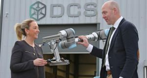 Sandra McCaffrey of DCS and Fine Gael councillor Paul Ross: 'I do appreciate the irony of a robotics company bringing jobs to a town said to be most at risk from robots.' Photograph: Shelley Corcoran for The Irish Times