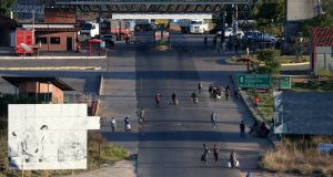 People cross the border from Venezuela to Brazil in Pacaraima, Brazil. Photograph: Reuters/Ricardo Moraes