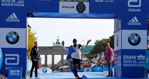 Kenya's Eliud Kipchoge celebrates as he wins the Berlin Marathon and breaks the world record in September 2018 while wearing Nike's Zoom Vaporfly 4%. Photograph:  Fabrizio Bensch/Reuters