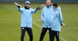 Manchester City manager Pep Guardiola with his assistants   during a training session ahead of their  Carabao Cup final against Chelsea. Photograph:  PA Wire