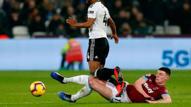 West Ham United's Declan Rice tackles Fulham's Denis Odoi. Photograph: Getty Images