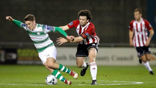 Dylan Watts of Shamrock Rovers and Barry McNamee of Derry City. Photo: Ryan Byrne/Inpho