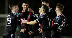 Bohemians' Daniel Mandroiu celebrates scoring a goal with team-mates during the SSE Airtricity League Premier Division match against  UCD at the UCD Bowl. Photograph: Laszlo Geczo/Inpho