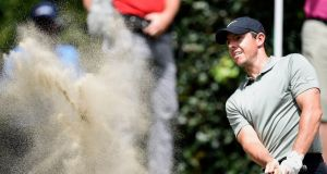 Rory  McIlroy blasts out of a greenside bunker on the first hole during the second round of the  WGC-Mexico Championship  at Chapultepec Golf Club in Mexico City. Photograph:  Alfredo Estrella/AFP/Getty Images
