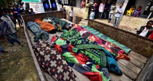 Bodies of tea plantation workers, who died after consuming bootleg alcohol, outside a government-run hospital in Golaghat in the northeastern state of Assam, India. Photograph:Reuters