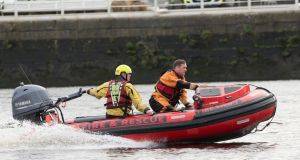 Fire and Search and Rescue personnel on  Shannon river this Saturday morning after a boat capsized in front of Athlunkard Boat Club. Photograph: Liam Burke/Press 22
