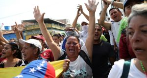 Opposition demonstrators appeal to security forces in Urena, Venezuela. Photograph: Andres Martinez Casares/Reuters