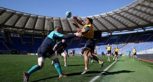 Peter O'Mahony and  Bundee Aki during the Ireland  Captain's Run at the  Stadio Olimpico in Rome. Photograph: Dan Sheridan/Inpho