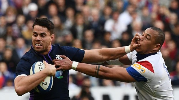 Scotland's winger Sean Maitland fends off France's centre Gael Fickou. Photograph: Anne-Christine Poujoulat/Getty Images