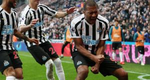Newcastle United's Salomon Rondon celebrates scoring their first goal in the Premier League game against Huddersfield Town  at St James' Park.   Photograph: Scott Heppell/Reuters