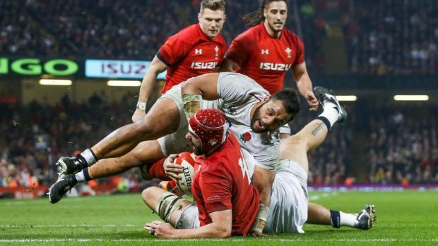 Wales' Cory Hill scores his try despite England's Billy Vunipola. Photograph: Ryan Byrne/Inpho