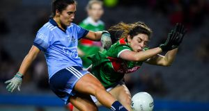 Róisín Flynn of Mayo attempts to block  Hannah O'Neill of Dublin during the   Lidl Ladies NFL Division  match  at Croke Park. Photograph: Ray McManus/Sportsfile