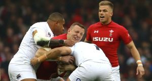 England's Kyle Sinckler  tackles Wales centre Hadleigh Parkes during the Six Nations  match at  the Principality Stadium. Photograph:   Geoff Caddick/AFP