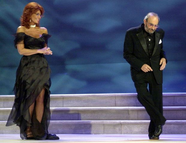Stanley Donen dancing on the stage as Sophia looks on at the Venice Film Festival in 2004. Photograph: Luigi Costantini/AP