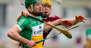 Offaly's Paddy Rigney is challenged by  Davey Glennon of Galway during the Allianz Hurling League Division 1B match at  O'Connor Park in Tullamore. Photograph: Tommy Dickson/Inpho