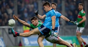 Dublin's Con O'Callaghan  gets his shot away despte the attempted block from Mayo's Lee Keegan at Croke Park.  Photograph: Morgan Treacy/Inpho