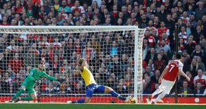 Arsenal's Henrikh Mkhitaryan scores their second goal during the Premier League win over Southampton. Photo: Peter Nicholls/Reuters
