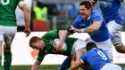Ireland's Keith Earls  dives to score a try despite  tackles from Italy's  Tito Tebaldi and  Alessandro Zanni during the Six Nations match  at the Stadio Olimpico in Rome. Photograph: VIncenzo Pinto/AFP/Getty Images