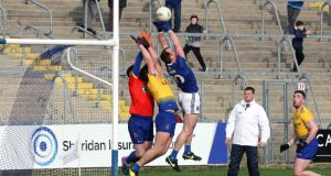 Cavan's Martin Reilly gets a score despite the attentions Darren O'Mailey and Conor Hussey of Roscommon. Photograph: Freddie Parkinson/Inpho