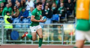 Ireland's Jacob Stockdale runs in a try. Photograph: James Crombie/Inpho
