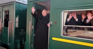 North Korean leader Kim Jong-un   boards a train in Pyongyang for Hanoi, Vietnam, for a second US-North Korea summit. Handout photograph: KCNA/EPA