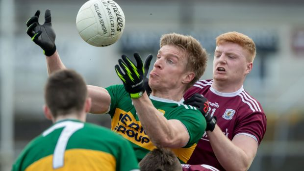 Galway's David Cunnane with Tommy Walsh of Kerry. Photo: Morgan Treacy/Inpho