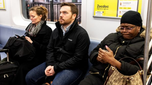 Kevin Roose rides the subway in New York during a 30-day smartphone detox. Photograph: Demetrius Freeman/The New York Times