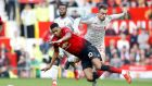 Manchester United's Marcus Rashford  and Liverpool's Xherdan Shaqiri battle for the ball during the Premier League match at Old Trafford. Photograph:   Martin Rickett/PA Wire
