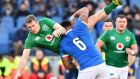 Italy's flanker Jimmy Tuivaiti  tackles Ireland's centre Chris Farrell during the Six Nations international clash at the   Olympic stadium in Rome. Photograph: Cincenzo Pinto/AFP/Getty