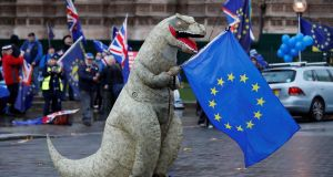 A demonstrator, dressed as a dinosaur, waves a European Union flag during a protest outside of the Houses of Parliament in central London last November. Photograph:  Tolga Akmen/AFP/Getty Images