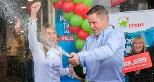 Barry and  Brenda Thompson, owners of the Spar store at  Upper O'Connell Street, Dublin  celebrate selling  the  winning ticket for Saturday's  Lotto jackpot. Photograph: Gareth Chaney Collins