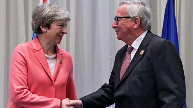 British prime minister Theresa May shakes hands with European Commission president Jean-Claude Juncker during a bilateral meeting on the sidelines of an EU-Arab League summit. Photograph: EPA