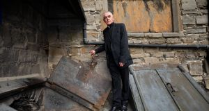 Archdeacon David Pierpoint at the entrance to the crypt at St Michan's Church. Photograph: Tom Honan