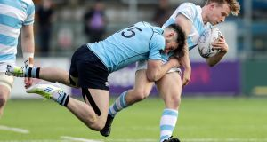 Blackrock College's Ben White is tackled by Andrew Smith of St. Michael's College. Photograph: Laszlo Geczo/Inpho