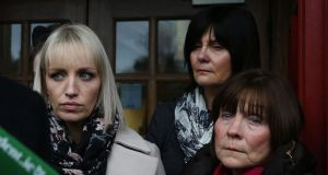 Clodagh Hawe's mother Mary Coll (right),  sister Jacqueline Connolly (left) and another family member  outside Cavan courthouse  following an inquest hearing into the deaths of the Hawe family in December 2017. File photograph: Brian Lawless/PA Wire
