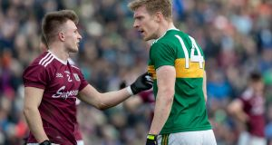 Galway's Eoghan Kerin and Tommy Walsh of Kerry exchange words during their Allianz Football League Division 1 match at  Tuam Stadium on Sunday. Photograph: Morgan Treacy/Inpho