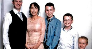 Alan Hawe with his wife Clodagh and their children Liam (13), Niall (11) and Ryan (6). Photograph: PA