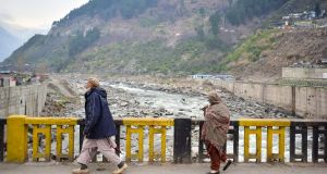 Pakistani residents walk on a bridge in the mountainous area of Balakot where the Indian Air Force launched a raid on Tuesday. Photograph: Getty Images