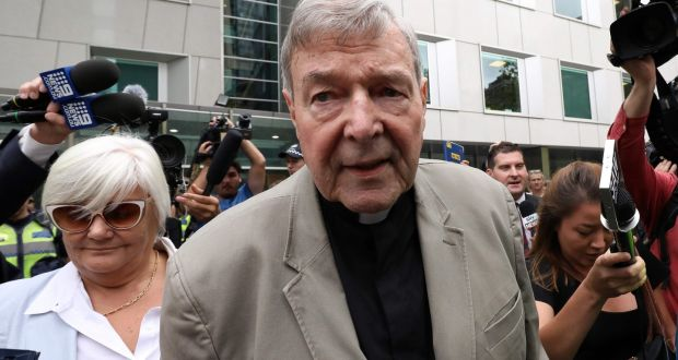 Cardinal George Pell (C) has been found guilty of sexually assaulting two choirboys. Photograph: ASANKA BRENDON RATNAYAKE/AFP/Getty Images