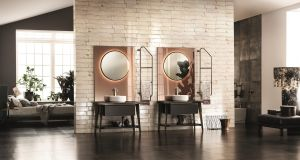 Scavolini x Diesel Living features on-trend circular mirrors that are ambiently back-lit