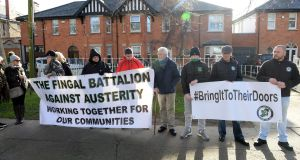 Protesters  outside the home of Minister for Communications, Climate Action and Environment Richard Bruton  on Griffith Avenue in Drumcondra, Dublin, recently. Photograph: Dara Mac Dónaill