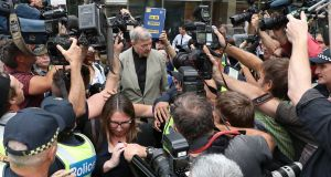 Cardinal George Pell  leaves the county court in Melbourne on Tuesday. Photograph: David Crosling/EPA