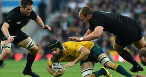 Scott Fardy  is tackled by New Zealand's prop Joe Moody in the 2015 Rugby World Cup final.  Australia beat the All Blacks to the 2015 Rugby Championship but lost to them in the World Cup final. Photograph:   Gabriel Bouys/AFP/Getty Images
