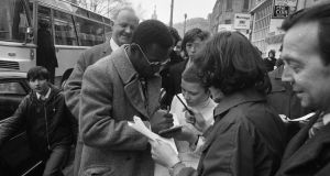 Brazilian start Pelé signs autographs on O'Connell Street during his stay in Dublin with Santos in February 1972. Photograph:  Getty Images