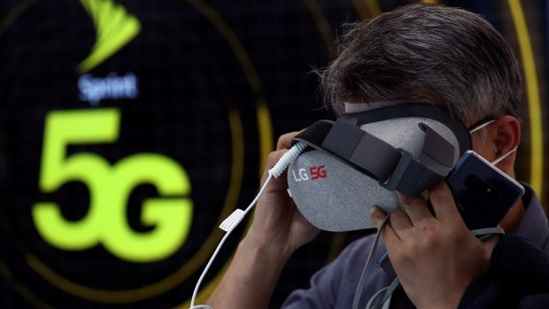 A man tests an LG 5G virtual reality device inside the LG booth at the Mobile World Congress. Photograph: Reuters