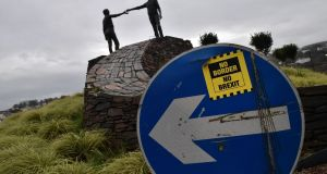 A 'No Border No Brexit' sticker near the Hands across the Divide peace statue in Derry. Photograph: Charles McQuillan/Getty Images