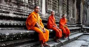 Monks make their way to Angkor Wat, five kilometres north of  Siem Reap. It is hidden among forests. The temples took their place on the UNESCO World Heritage List in 1992