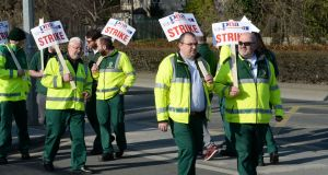 Ambulance personnel on strike at the ambulance service facility on Davitt Road in Dublin earlier this month. Photograph: Alan Betson